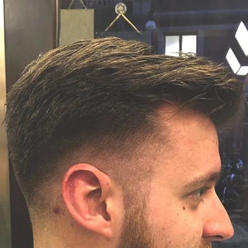 Taglio uomo moderno sfumato eseguito da Figaro, barbiere di Torino